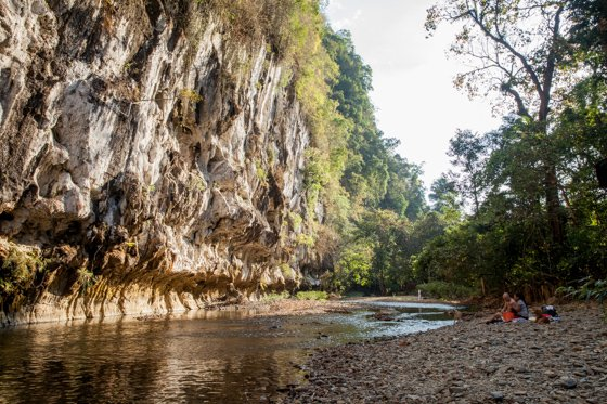 Our Jungle House river beach looking over towering limestone cliffs.